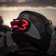 Brake Free on a Shoei RF1200 helmet. Autonomous brake light accessory for motorcycle helmets. High visibility.