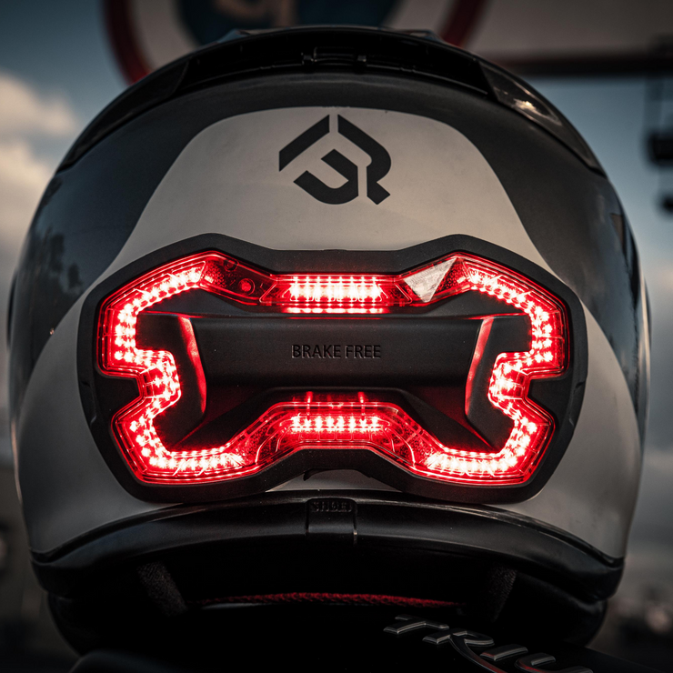Brake Free - an ultra-bright smart LED brake light that instantly improves rider's visibility. Simple installation, no wires. Smart brake light for your helmet. Be seen day and night. Ride in any weather. Long lasting rechargeable lithium ion battery.