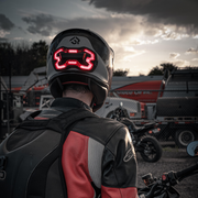 Lifestyle photo of Brake Free. Brake Free is an ultra-bright smart LED brake light that instantly improves rider's visibility. Simple installation, no wires. Smart brake light for your helmet. Be seen day and night. Ride in any weather. Long lasting rechargeable lithium ion battery.