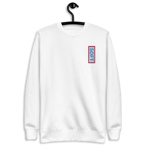 White fleece pullover from Soft Shop with vertical Soft blue lettering in red box