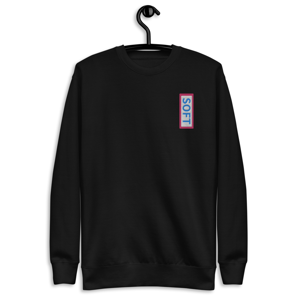 Black fleece pullover from Soft Shop with vertical Soft blue lettering in red box
