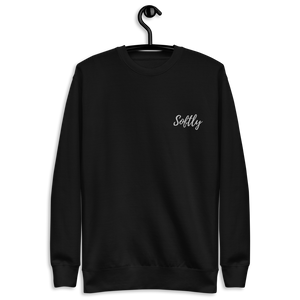 Black long sleeve fleece pullover sweater with white embroidered fancy cursive text SOFTLY
