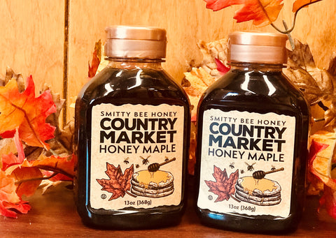 A pair of 13oz. Jars Country Market Honey Maple Syrup