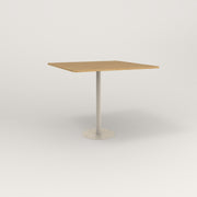 RAD Cafe Table, Rectangular 4 Top Bolt Down Base in white oak europly and off-white powder coat.