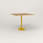 RAD Cafe Table, Rectangular 4 Top Bolt Down Base in white oak europly and yellow powder coat.