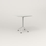 RAD Cafe Table, Rectangular 2 Top Tube Four Point Base in perforated steel and white powder coat.