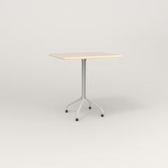 RAD Cafe Table, Rectangular 2 Top Tube Four Point Base in solid ash and white powder coat.