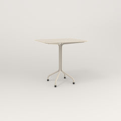 RAD Cafe Table, Rectangular 2 Top Tube Four Point Base in perforated steel and off-white powder coat.