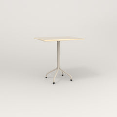 RAD Cafe Table, Rectangular 2 Top Tube Four Point Base in solid ash and off-white powder coat.