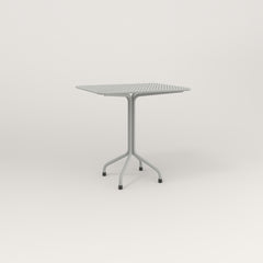 RAD Cafe Table, Rectangular 2 Top Tube Four Point Base in perforated steel and grey powder coat.