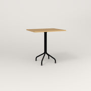 RAD Cafe Table, Rectangular 2 Top Tube Four Point Base in white oak europly and black powder coat.