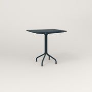 RAD Cafe Table, Rectangular 2 Top Tube Four Point Base in perforated steel and navy powder coat.