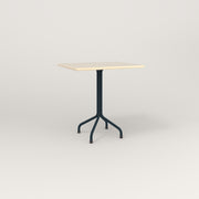RAD Cafe Table, Rectangular 2 Top Tube Four Point Base in solid ash and navy powder coat.
