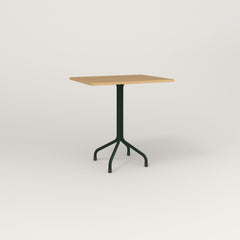 RAD Cafe Table, Rectangular 2 Top Tube Four Point Base in white oak europly and fir green powder coat.