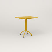 RAD Cafe Table, Rectangular 2 Top Tube Four Point Base in perforated steel and yellow powder coat.