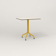 RAD Cafe Table, Rectangular 2 Top Tube Four Point Base in hpl and yellow powder coat.