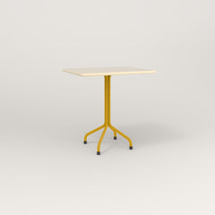 RAD Cafe Table, Rectangular 2 Top Tube Four Point Base in solid ash and yellow powder coat.