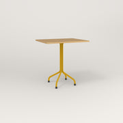RAD Cafe Table, Rectangular 2 Top Tube Four Point Base in white oak europly and yellow powder coat.