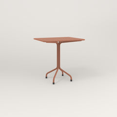 RAD Cafe Table, Rectangular 2 Top Tube Four Point Base in perforated steel and coral powder coat.