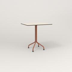 RAD Cafe Table, Rectangular 2 Top Tube Four Point Base in hpl and coral powder coat.