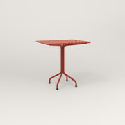 RAD Cafe Table, Rectangular 2 Top Tube Four Point Base in perforated steel and red powder coat.