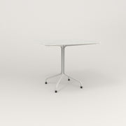 RAD Cafe Table, Rectangular 4 Top Tube Four Point Base in perforated steel and white powder coat.
