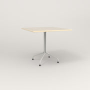 RAD Cafe Table, Rectangular 4 Top Tube Four Point Base in solid ash and white powder coat.