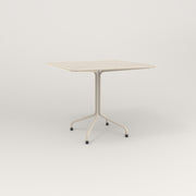 RAD Cafe Table, Rectangular 4 Top Tube Four Point Base in perforated steel and off-white powder coat.