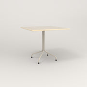 RAD Cafe Table, Rectangular 4 Top Tube Four Point Base in solid ash and off-white powder coat.