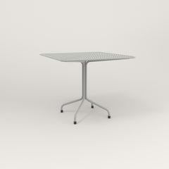 RAD Cafe Table, Rectangular 4 Top Tube Four Point Base in perforated steel and grey powder coat.