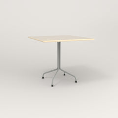 RAD Cafe Table, Rectangular 4 Top Tube Four Point Base in solid ash and grey powder coat.