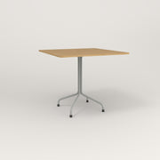 RAD Cafe Table, Rectangular 4 Top Tube Four Point Base in white oak europly and grey powder coat.
