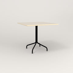 RAD Cafe Table, Rectangular 4 Top Tube Four Point Base in solid ash and black powder coat.