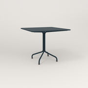 RAD Cafe Table, Rectangular 4 Top Tube Four Point Base in perforated steel and navy powder coat.