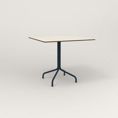 RAD Cafe Table, Rectangular 4 Top Tube Four Point Base in hpl and navy powder coat.