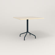 RAD Cafe Table, Rectangular 4 Top Tube Four Point Base in solid ash and navy powder coat.