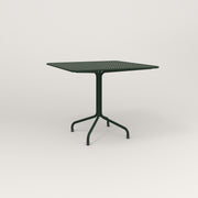 RAD Cafe Table, Rectangular 4 Top Tube Four Point Base in perforated steel and fir green powder coat.