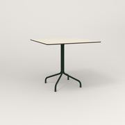 RAD Cafe Table, Rectangular 4 Top Tube Four Point Base in hpl and fir green powder coat.