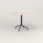 RAD Cafe Table, Rectangular 4 Top Tube Four Point Base in solid ash and fir green powder coat.