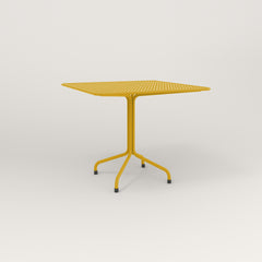 RAD Cafe Table, Rectangular 4 Top Tube Four Point Base in perforated steel and yellow powder coat.