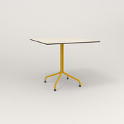 RAD Cafe Table, Rectangular 4 Top Tube Four Point Base in hpl and yellow powder coat.