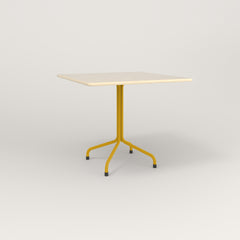 RAD Cafe Table, Rectangular 4 Top Tube Four Point Base in solid ash and yellow powder coat.