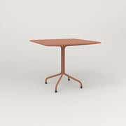 RAD Cafe Table, Rectangular 4 Top Tube Four Point Base in perforated steel and coral powder coat.