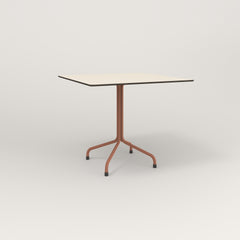 RAD Cafe Table, Rectangular 4 Top Tube Four Point Base in hpl and coral powder coat.