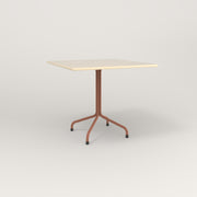 RAD Cafe Table, Rectangular 4 Top Tube Four Point Base in solid ash and coral powder coat.