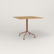 RAD Cafe Table, Rectangular 4 Top Tube Four Point Base in white oak europly and coral powder coat.
