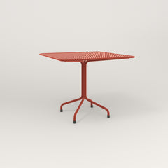 RAD Cafe Table, Rectangular 4 Top Tube Four Point Base in perforated steel and red powder coat.
