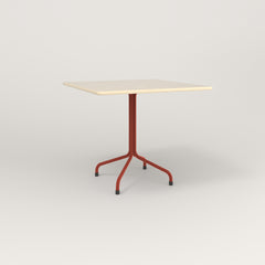 RAD Cafe Table, Rectangular 4 Top Tube Four Point Base in solid ash and red powder coat.
