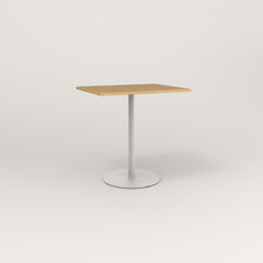 RAD Cafe Table, Rectangular Weighted Base in white oak europly and white powder coat.