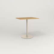 RAD Cafe Table, Rectangular Weighted Base in white oak europly and off-white powder coat.